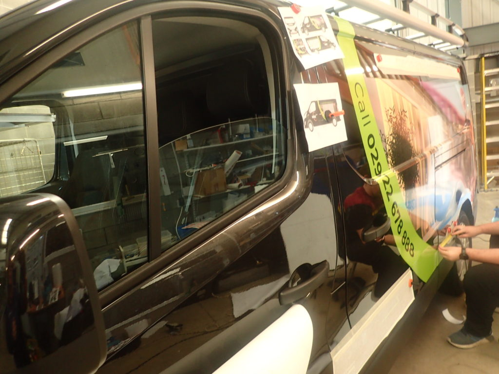 A van being wrapped for Solar Sunshades by Elite Signs Bridgend